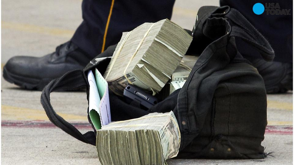 $600,000 dug up By FBI in yard of armored truck driver