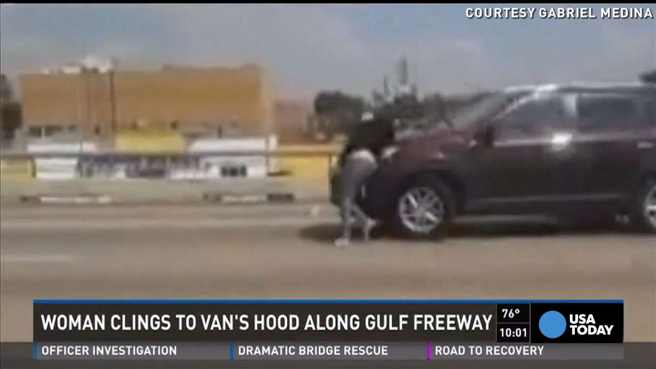 Pregnant woman clings to hood of moving car