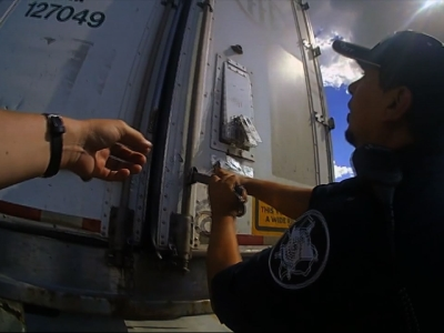 Raw: 39 Immigrants Found in Locked 18-Wheeler