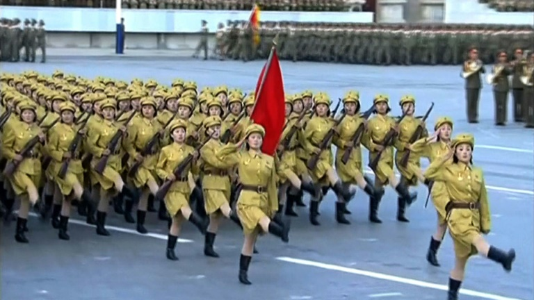 North Korean leader Kim Jong Un gestures as he watches a military parade in Pyongyang, North Korea.