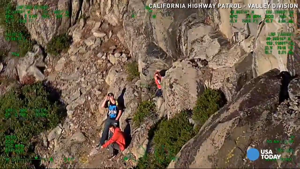 Watch helicopter team rescue stranded hikers from cliff