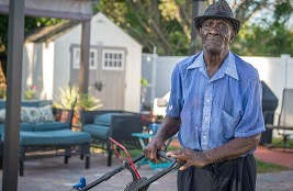 Why this 83-year-old walks miles to mow lawns
