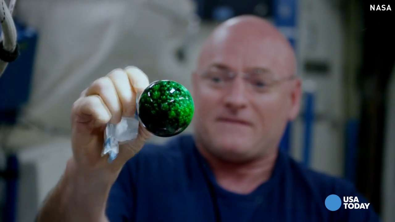 Astronauts add color to floating ball of water in space
