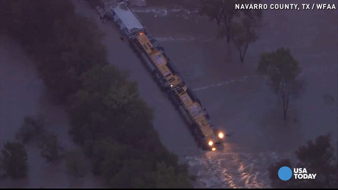 Train derails in Texas as flood washes away cars