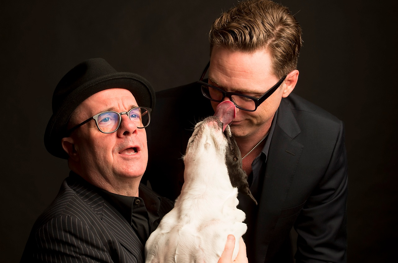 "Nathan Lane and Devlin Elliott with their French bulldog ""Mabel,"" the inspiration for their book ""Naughty Mabel."""