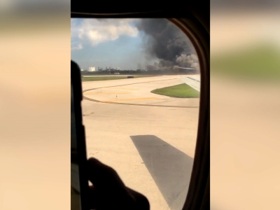 A passenger plane's engine caught fire Thursday as it prepared for takeoff at Fort Lauderdale/Hollywood International Airport. Passengers had to quickly evacuate using emergency slides, officials said. (Oct. 29)