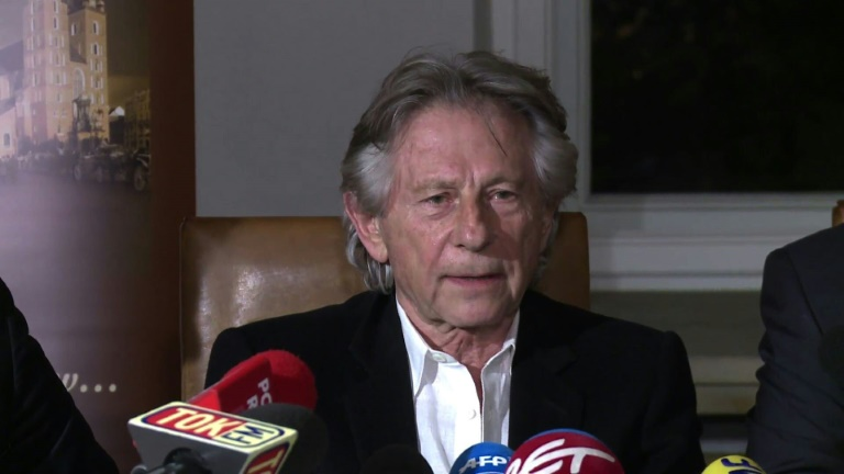 """FILE - In this file photo, filmmaker Roman Polanski tells reporters he can """"breathe with relief"""" after a Polish judge ruled that the law forbids his extradition to the U.S."""