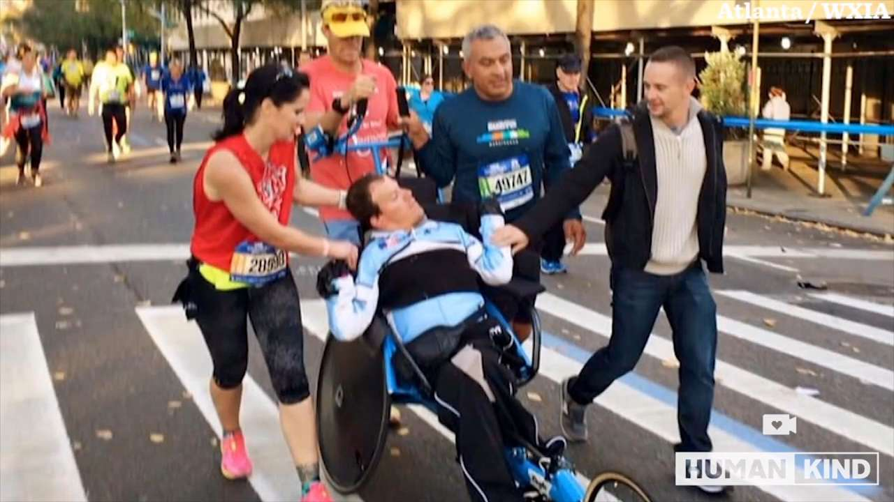 NYC Marathon runners help Kyle and Brent Pease finish the race.