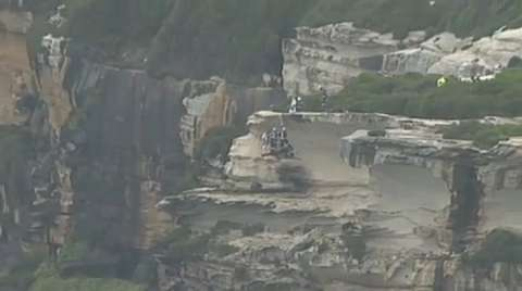 Watch tense rescue of 2 men from iconic Aussie cliff
