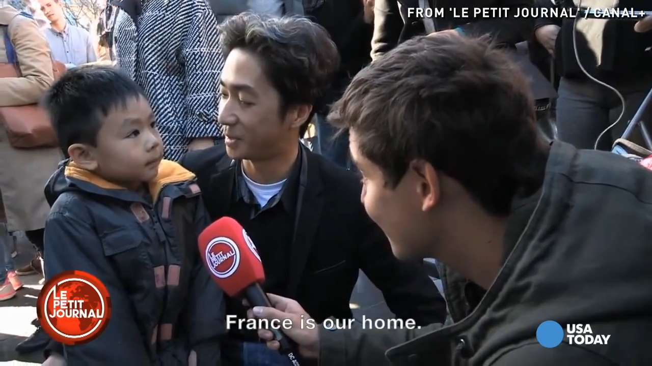 Dad teaches son not to fear after Paris attacks
