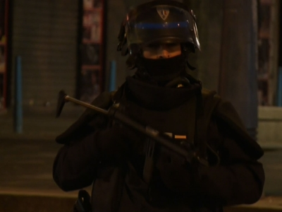 Suspects in Paris attacks, police exchange gunfire in raids
