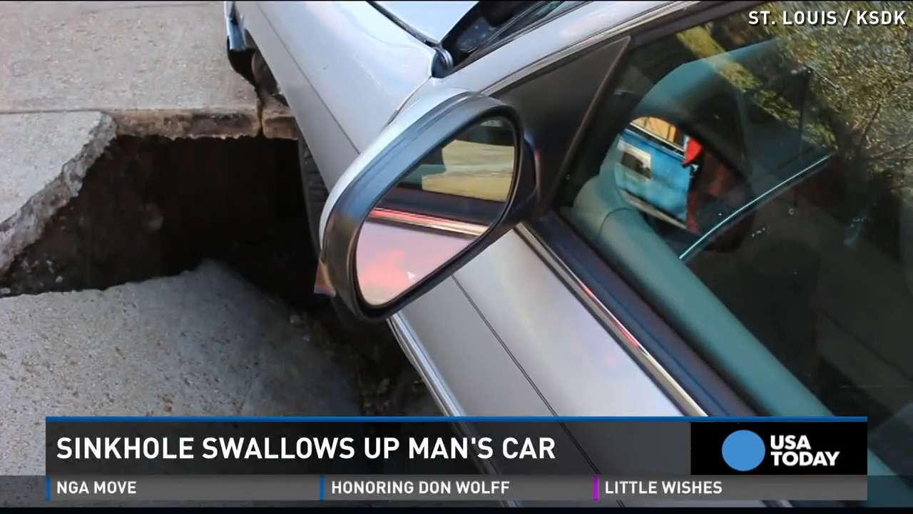 Sinkhole starts swallowing man's car while he's inside