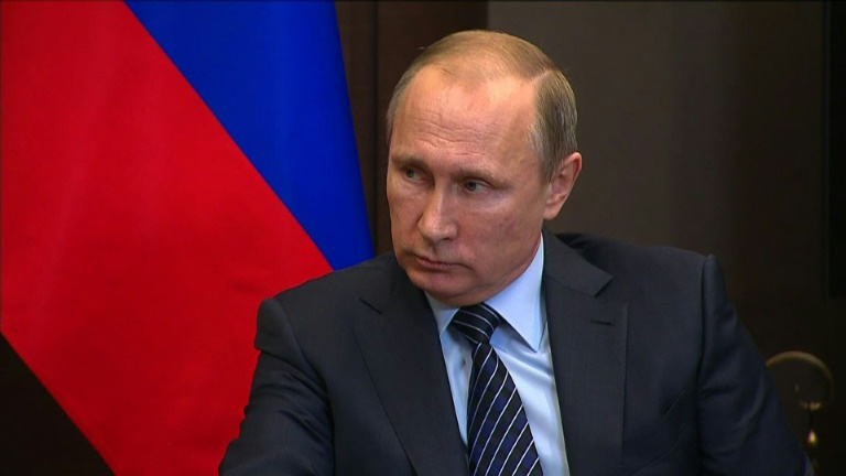 Putin warns Turkey after Russian jet downed