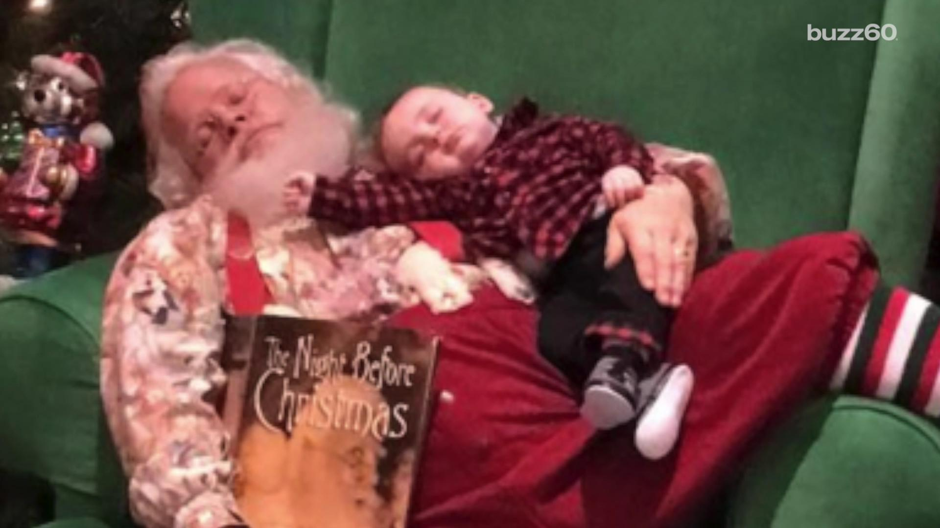 Saavy Santa knows just what to do with a sleeping baby