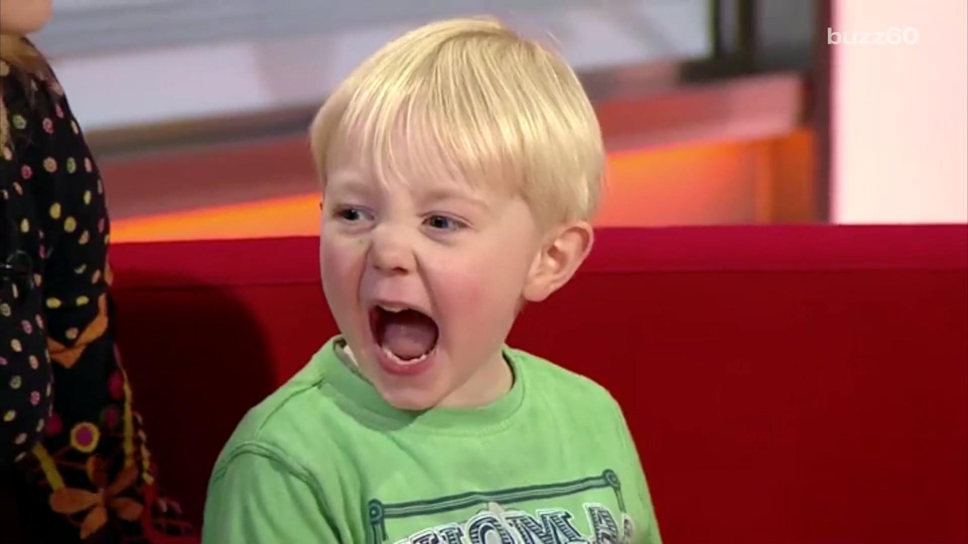This kid can't stop the giggles during a live interview
