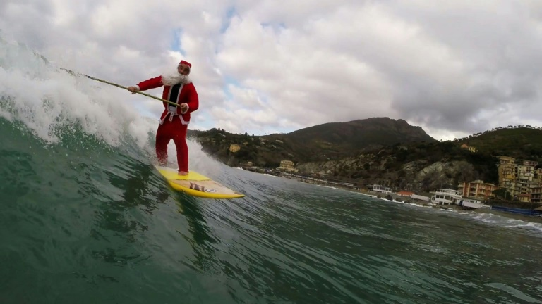Santa swaps sleigh for surf to ride Italian waves