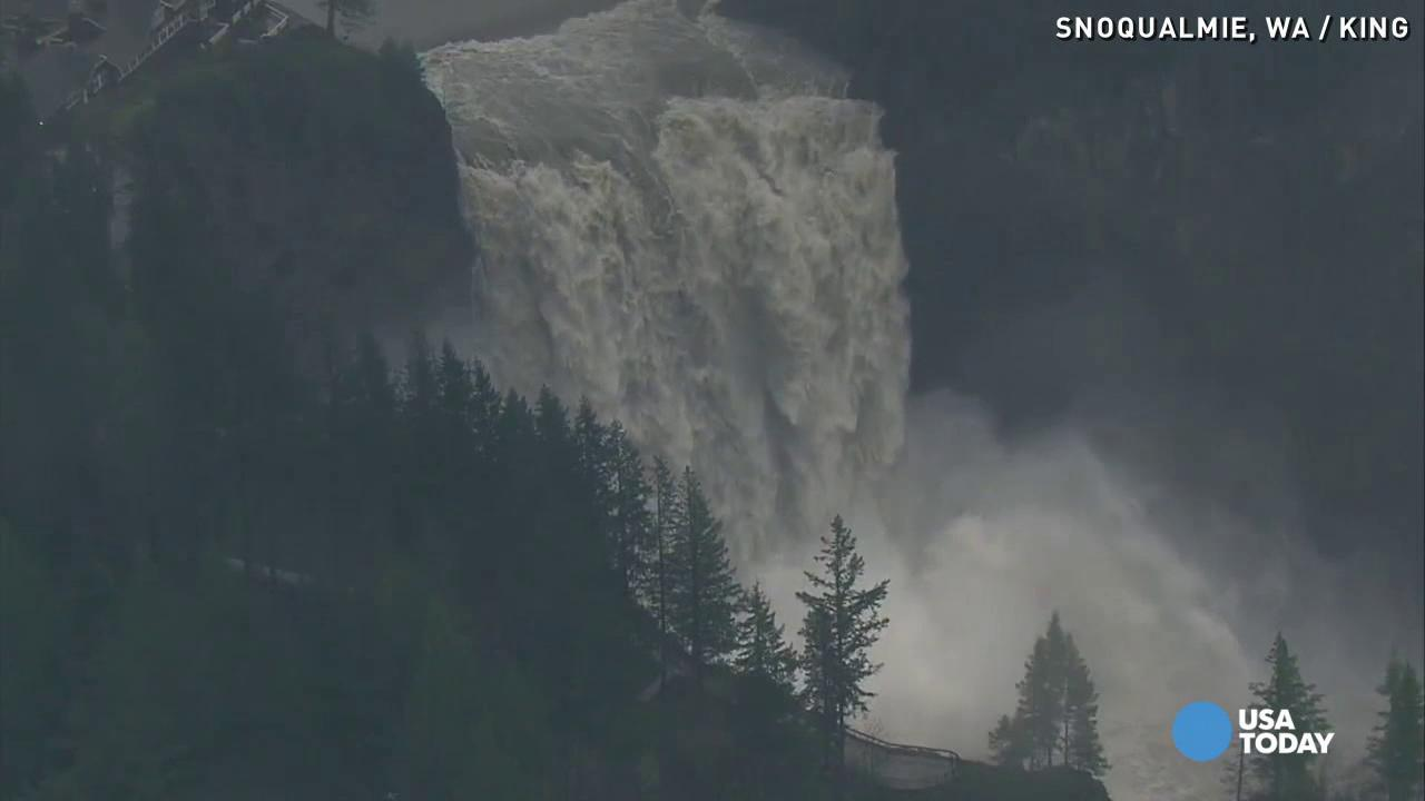 As Washington state and the Pacific Northwest are hit with heavy rain and flood risks, a surging Snoqualmie Falls is captured in aerial footage.