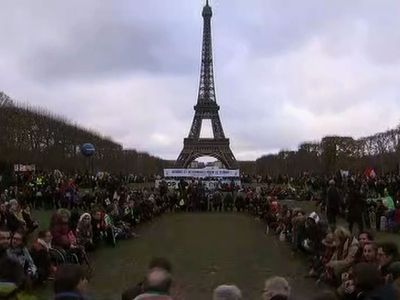 Paris protesters denounce climate accord