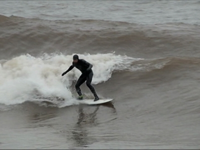 Surfers catch waves on Lake Superior