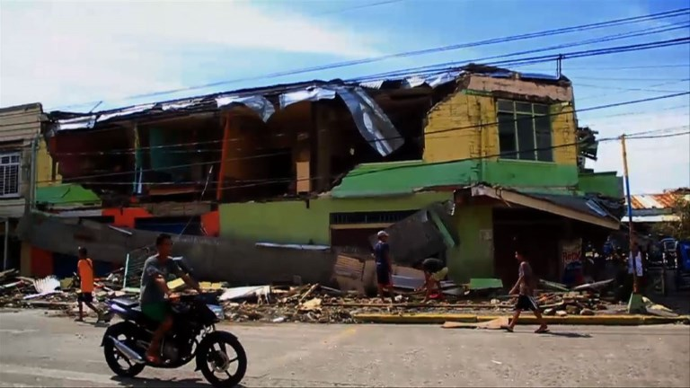 Typhoon kills 4 in Philippines, cuts power ahead of Christmas