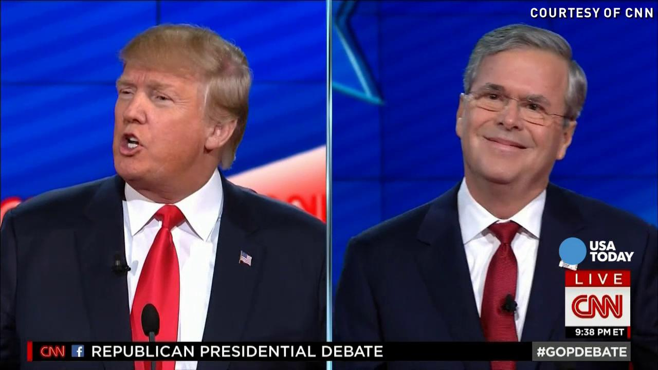 Donald Trump and Jeb Bush are seen on television monitors in the media room during the CNN Republican presidential debate at the Venetian Hotel & Casino on Tuesday, Dec. 15, 2015, in Las Vegas.