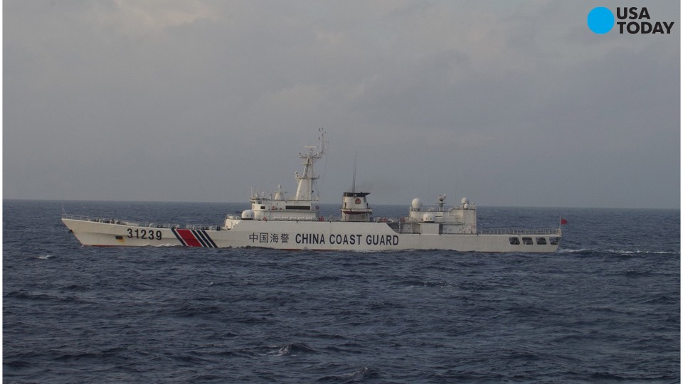 An armed Chinese coast guard ship sails in the water near islands, known as the Senkaku in Japanese and the Diaoyu in Chinese, on Dec. 22, 2015.