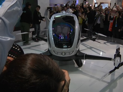 Raw: Human Transport Drone, Segway Robot At CES