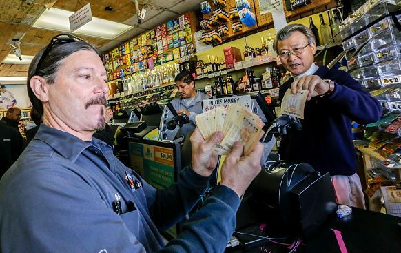 The Powerball jackpot has reached $900 million, the largest lottery prize in the U.S. history, after frenzied buy-ins across the country.
