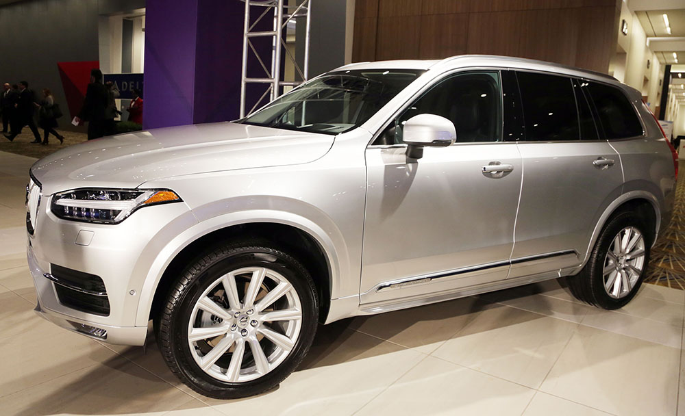 Mark Phelan of the Detroit Free Press reports from the North American International Auto Show where the Honda Civic and the Volvo XC90 were named the North American Car and Truvk of the Year.