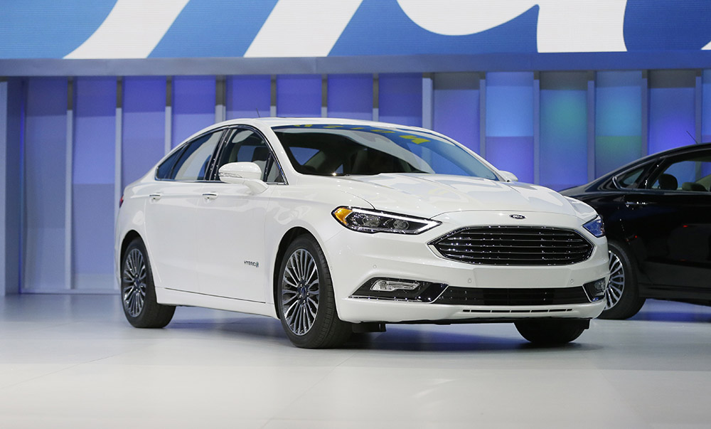 Ford reveals the new model of the popular Fusion at the North American International Auto Show in Detroit.