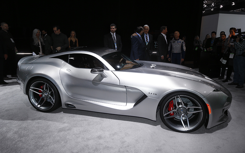 The feud between auto designer Henrik Fisker and Aston Martin was full display Tuesday at the North American International Auto Show. USA TODAY's Nathan Bomey explains the tiff, in which Aston Martin warned Fisker not to display his new supercar.