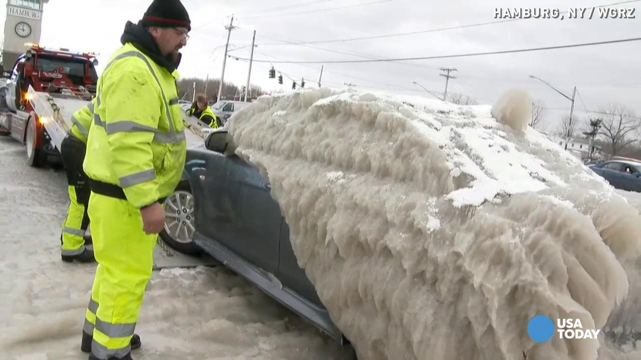 Car frozen for days finally freed from ice