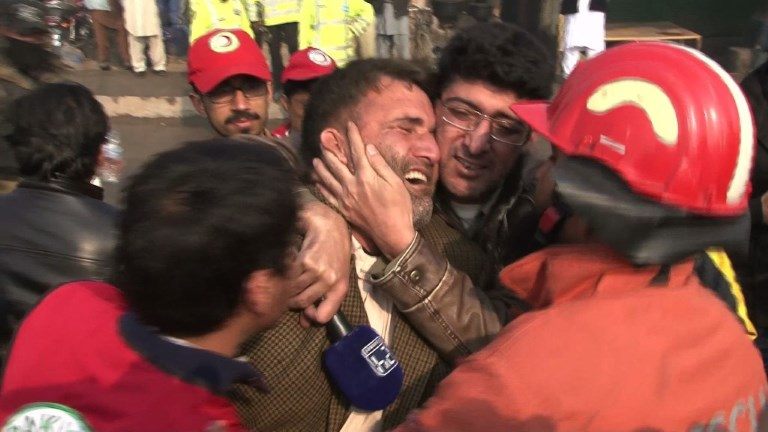 A suicide bomber killed at least 10 people Tuesday in a rush-hour attack on a market on the outskirts of the Pakistani city of Peshawar, officials said.