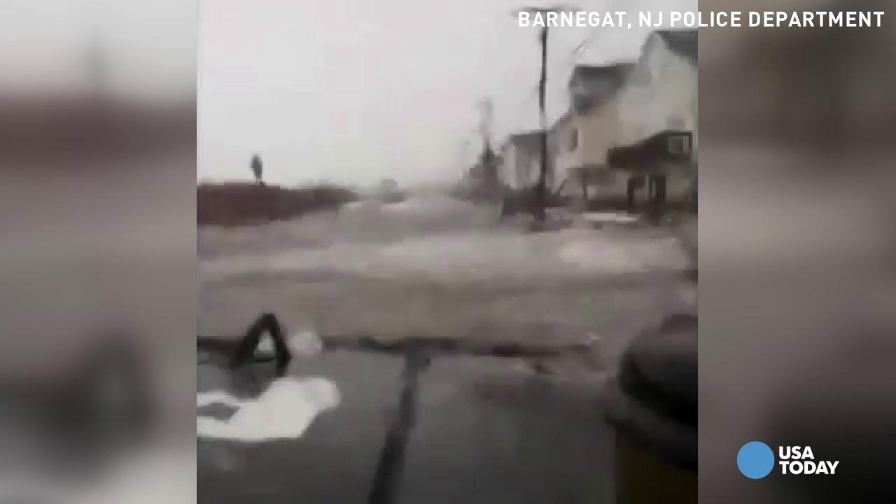 Roads buried in water as snowstorm brings major coastal flooding