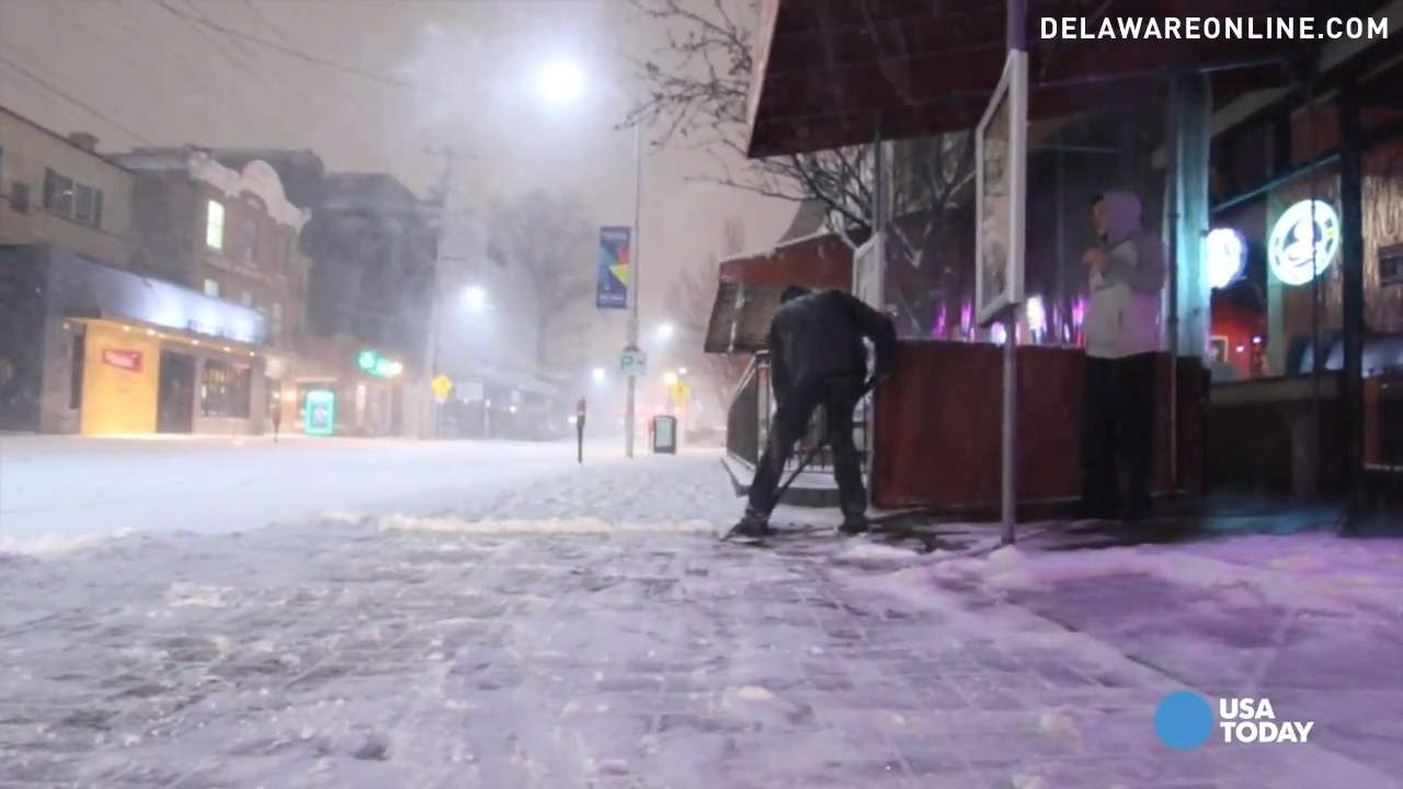 Historic blizzard slams East Coast, turns road into river