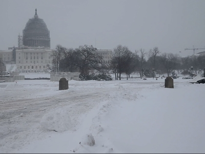Raw: Washington Monuments Blanketed in Snow
