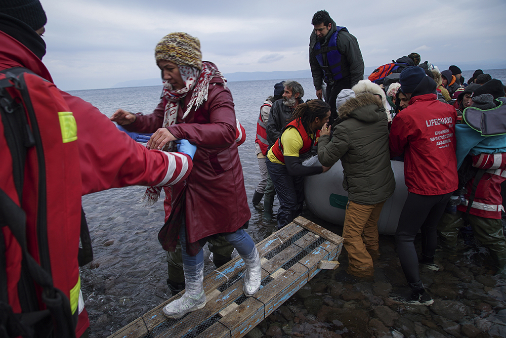 In this video hear the excitement as refugees approach the shores of Greece in a small boat.