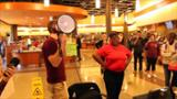 Students surprise dining-hall employee with dream trip