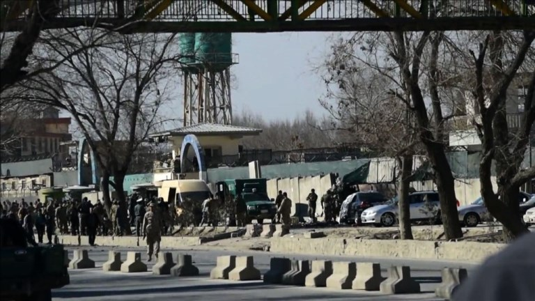 A Taliban suicide bomber strikes a police base in central Kabul, killing at least nine people just days before a fresh round of international talks aimed at reviving Taliban peace negotiations. Video provided by AFP