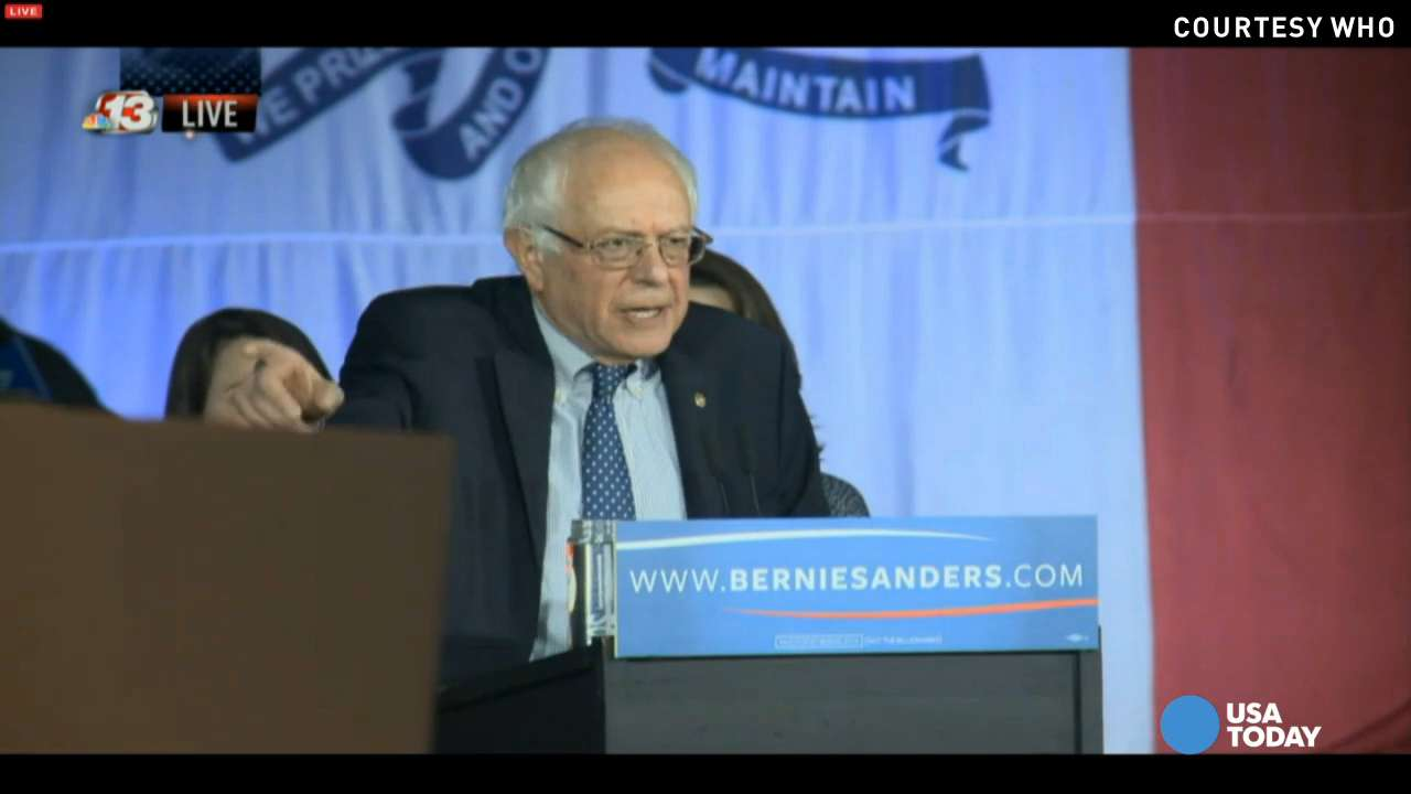 Bernie Sanders addresses a cheering crowd after the Iowa caucuses as he and Hillary Clinton remain locked in a tight battle.