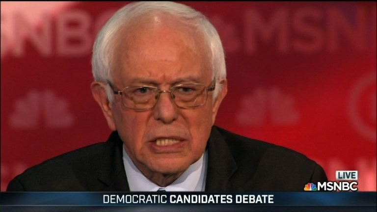 """Democrats Hillary Clinton and Bernie Sanders try to distance themselves from Wall Street during a party debate Thursday, with Sanders calling for a """"political revolution"""" that would limit the influence of wealthy interest groups. Video provided by A"""