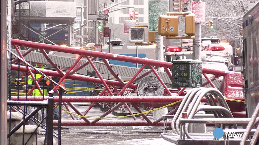 One person sitting in a parked car was killed and three people injured on Friday when a huge construction crane collapsed in lower Manhattan.