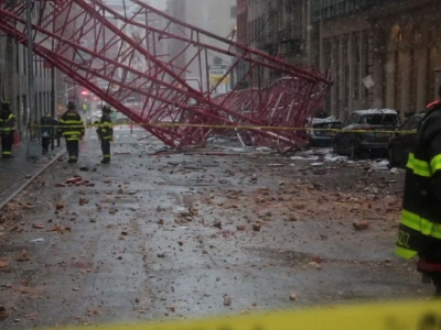 Firefighters began assessing the damage caused by a huge construction crane that collapsed onto a Lower Manhattan street Friday, killing a Wall Street worker in a parked car and leaving three people hurt by debris. (Feb. 5)