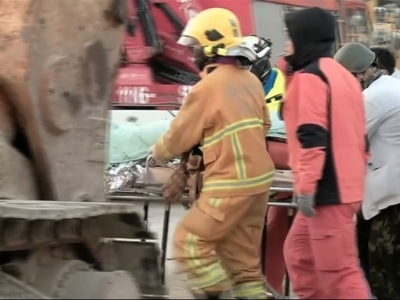A 18-year-old man was rescued on Sunday after he had been trapped for over 24 hours inside a building that collapsed when an earthquake struck Taiwan. Local broadcaster EBC also aired pictures of an unidentified man being reunited with his dog. (Feb