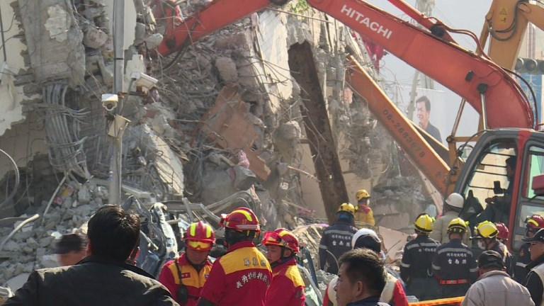 Rescuers race against time to free more than 100 people still buried beneath the rubble of apartment blocks felled by a powerful earthquake in southern Taiwan that left 18 dead. Video provided by AFP