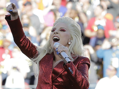 Lady Gaga has kicked things off at Super Bowl Sunday with a pre-game performance of the national anthem 'The Star-Spangled Banner.' (Feb. 7)
