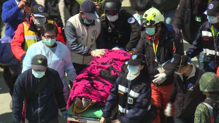 Two people are pulled alive from the rubble of an apartment complex in Taiwan, more than 50 hours after it was felled by a powerful earthquake, as rescuers race to find more than 100 who remain missing. Video provided by AFP