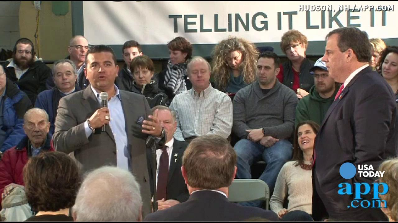 'Cake Boss' Buddy Valastro introduces Republican presidential candidate and New Jersey Governor Chris Christie to a Town Hall audience at Gilchrist Metal Company in Hudson, New Hampshire.