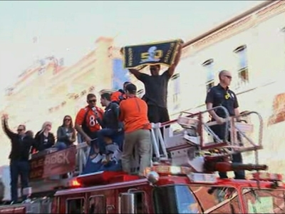 Tens of thousands of Denver Broncos fans cheered the Super Bowl champions during a parade through the Mile High City. (Feb. 9)
