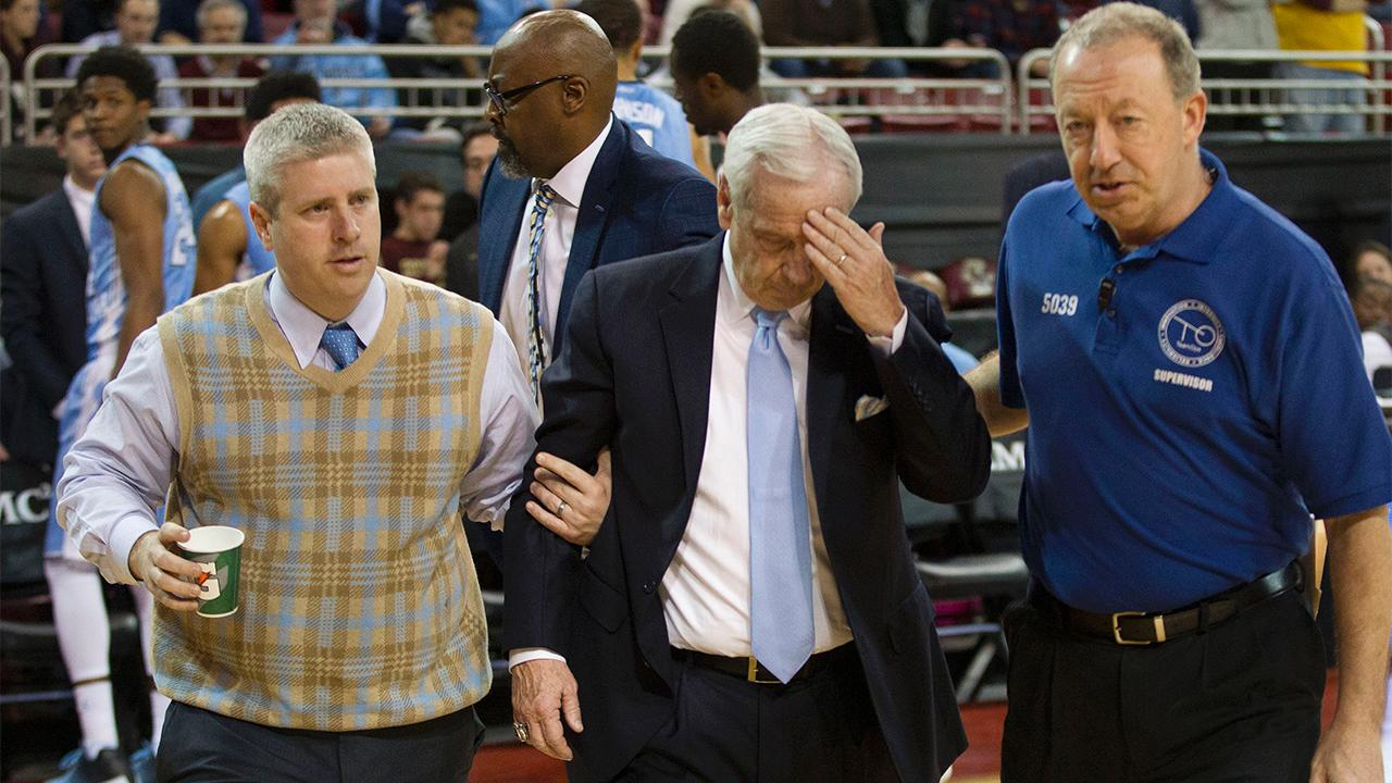 North Carolina coach Roy Williams appeared to collapse on the sideline during the Tar Heels' game against Boston College on Tuesday.